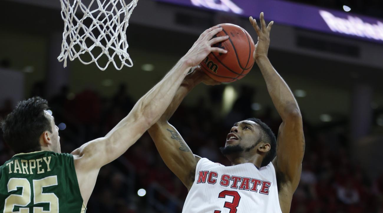William & Mary's Terry Tarpey (25) blocks the shot by N.C. State's Terry Henderson (3) during the first half of an NCAA college basketball game in Raleigh, N.C., Friday, Nov. 13, 2015.  (Ethan Hyman/The News & Observer via AP) MANDATORY CREDIT