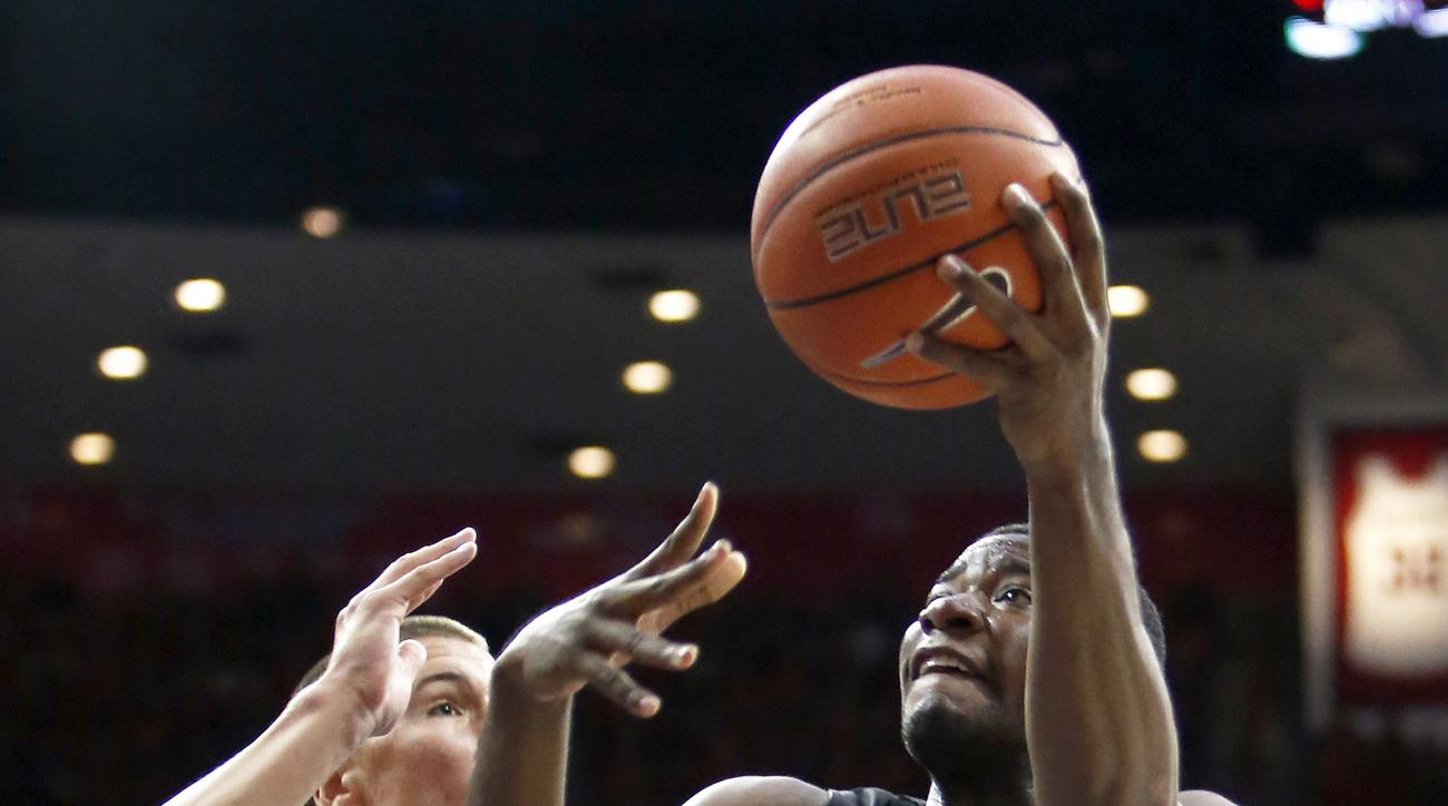 Pacific forward Anthony Townes (5) shoots against Arizona center Kaleb Tarczewski during the first half of an NCAA college basketball game, Friday, Nov. 13, 2015, in Tucson, Ariz. (AP Photo/Rick Scuteri)
