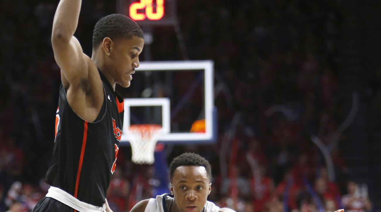 Arizona guard Parker Jackson-Cartwright (0) drives past Pacific guard D.J. Ursery during the second half of an NCAA college basketball game, Friday, Nov. 13, 2015, in Tucson, Ariz. (AP Photo/Rick Scuteri)