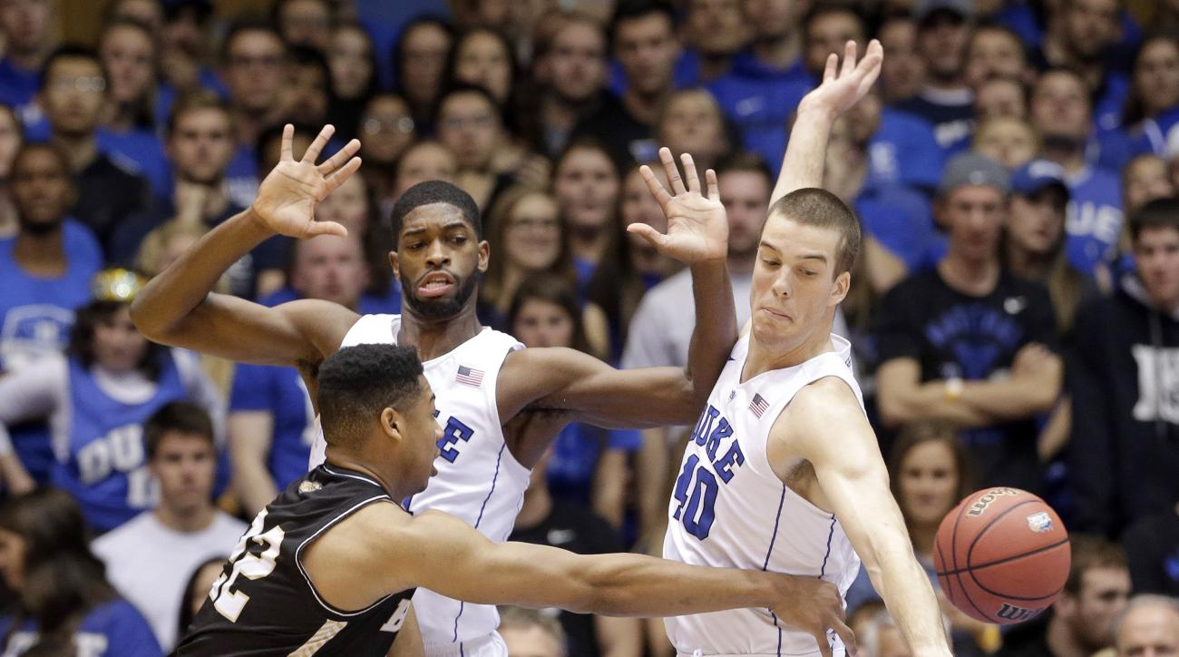 Duke's Amile Jefferson,center, and Marshall Plumlee, right,  pressure Bryant's Dan Garvin, left, during the first half of an NCAA college basketball game in Durham, N.C., Saturday, Nov. 14, 2015. (AP Photo/Gerry Broome)