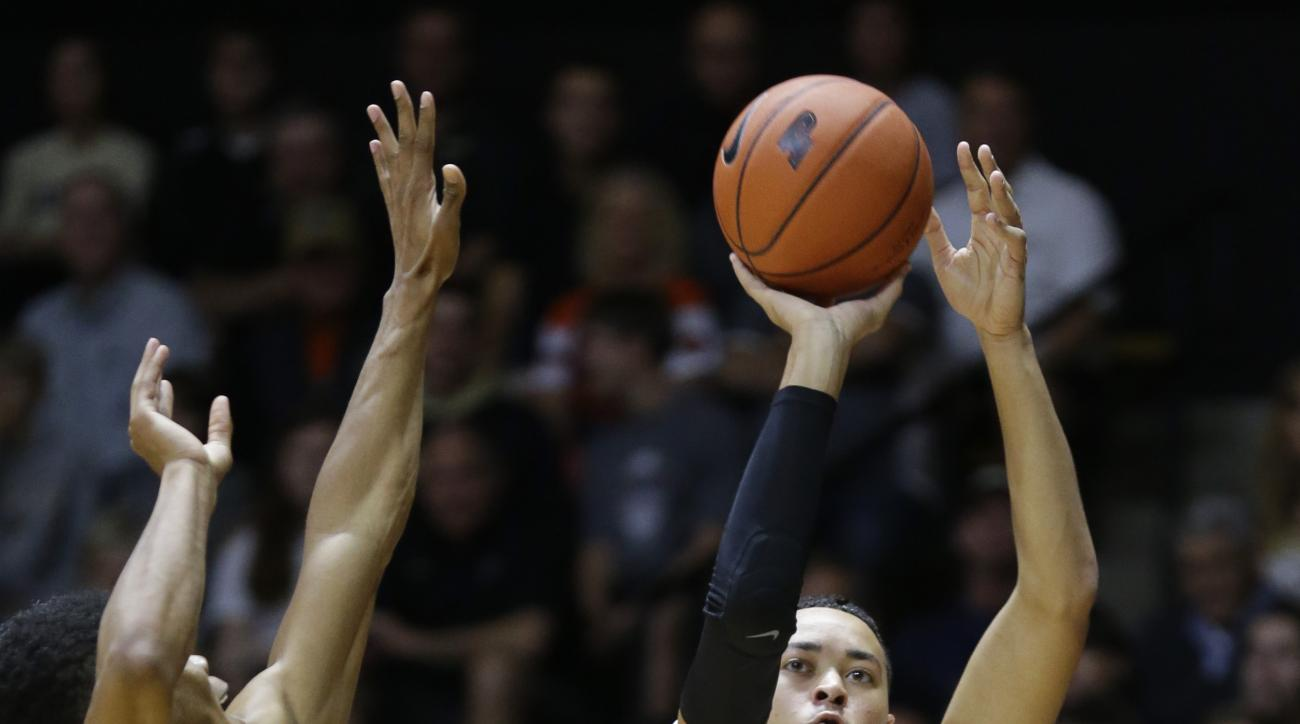 Purdue guard Kendall Stephens (21) shoots over Vermont guard Trae Bell-Haynes (2) in the first half of an NCAA college basketball game in West Lafayette, Ind., Sunday, Nov. 15, 2015.  (AP Photo/Michael Conroy)