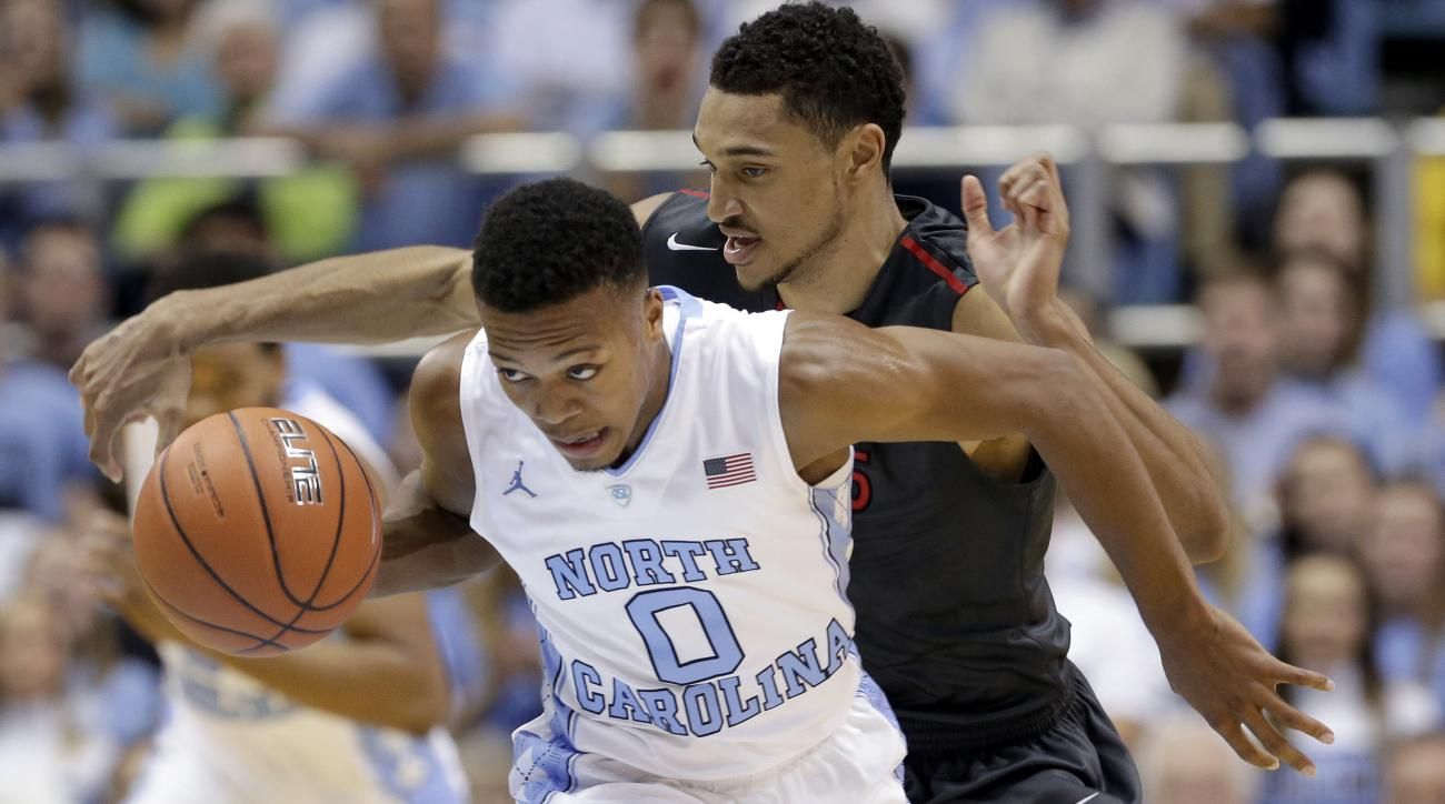North Carolina's Nate Britt (0) and Fairfield's Marcus Gilbert chase the ball during the first half of an NCAA college basketball game in Chapel Hill, N.C., Sunday, Nov. 15, 2015. (AP Photo/Gerry Broome)