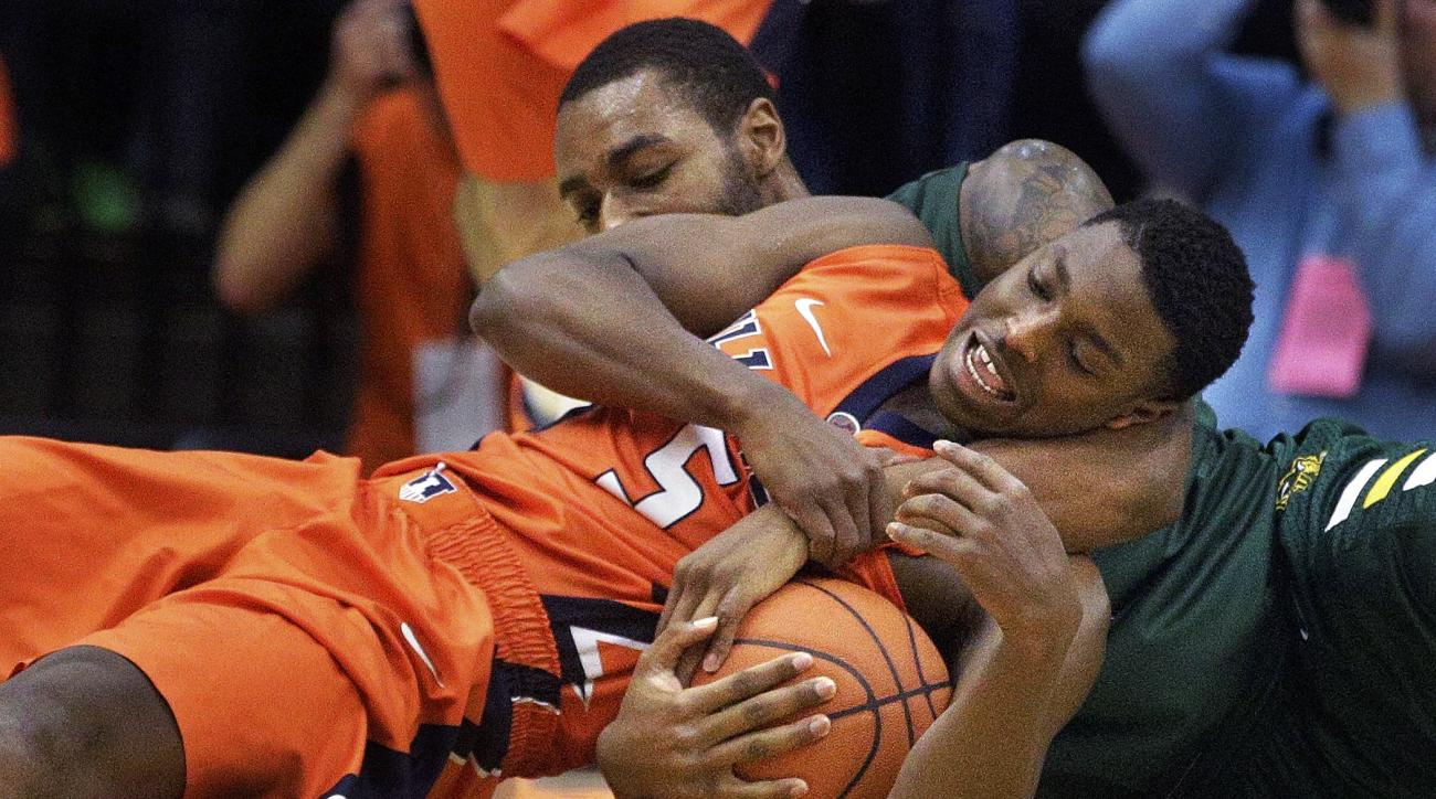 Illinois guard Jalen Coleman-Lands, bottom, and North Dakota State guard Kory Brown, top, struggle for a loose ball during the first half of an NCAA  college basketball game at the Prairie Capital Convention Center on Sunday, Nov. 15, 2015, in Springfield