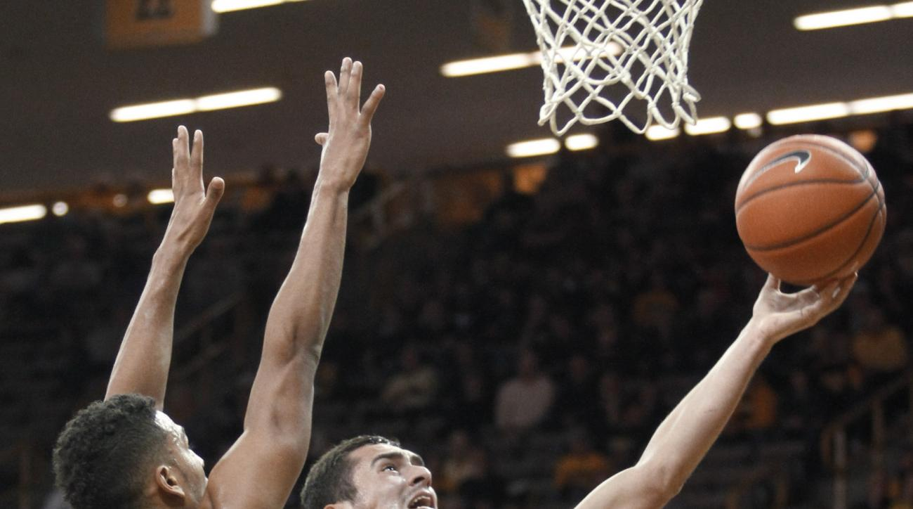 Iowa guard Andrew Flemming (2) drives to the basket against Coppin State guard Christian Kessee (10) during the first half of an NCAA college basketball game in Iowa City, Iowa, Sunday Nov. 15, 2015. (AP Photo/Matthew Holst)