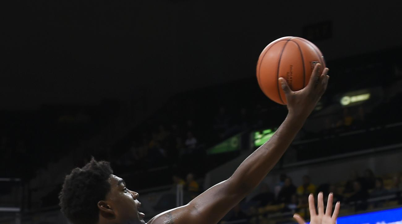 Missouri's Namon Wright, left, shoots over Maryland-Eastern Shore's Devin Martin, right, and Derrico Peck, center, during the first half of an NCAA college basketball game Sunday, Nov. 15, 2015, in Columbia, Mo. (AP Photo/L.G. Patterson)