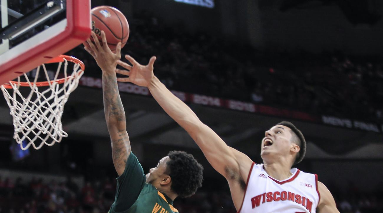 Siena's Marquis Wright (1) shoots past Wisconsin's Bronson Koenig (24) during the first half of an NCAA college basketball game Sunday, Nov. 15, 2015, in Madison, Wis. (AP Photo/Andy Manis)