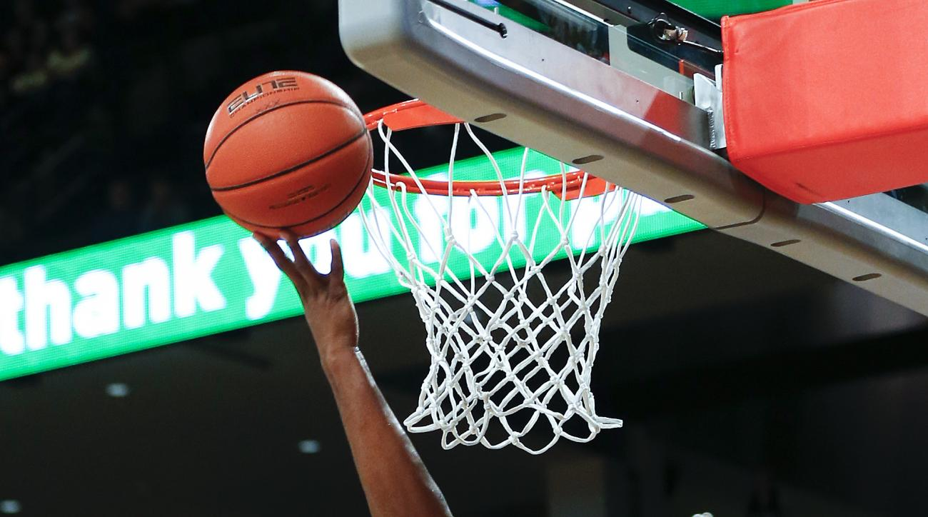 Georgia Tech forward Charles Mitchell (0) shoots as Tennessee forward Jabari McGhee second from left, defends in the first half of an NCAA college basketball game Monday, Nov. 16, 2015, in Atlanta. (AP Photo/John Bazemore)