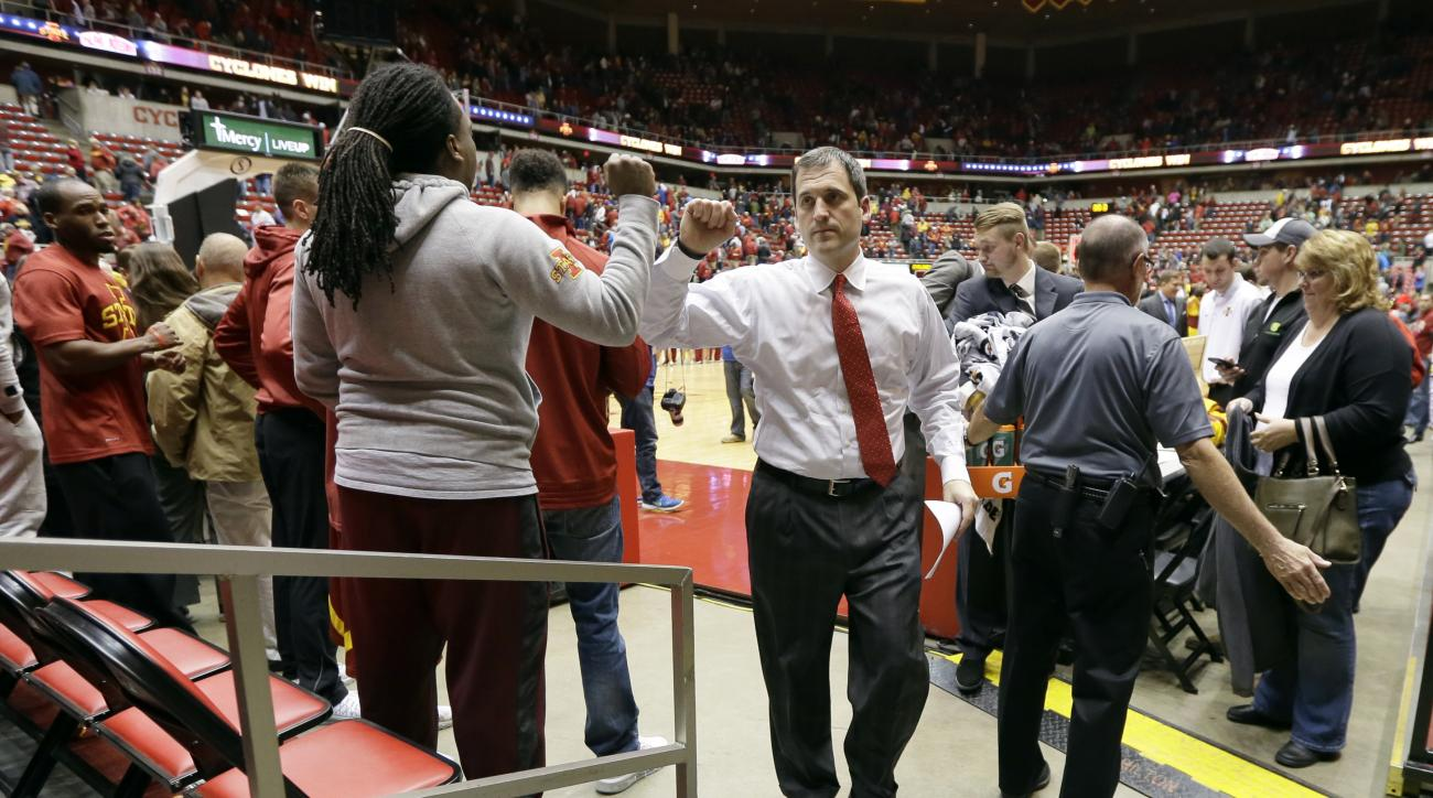Iowa State head coach Steve Prohm, center, walks off the court after an NCAA college basketball game against Chicago State, Monday, Nov. 16, 2015, in Ames, Iowa. Iowa State won 106-64. (AP Photo/Charlie Neibergall)