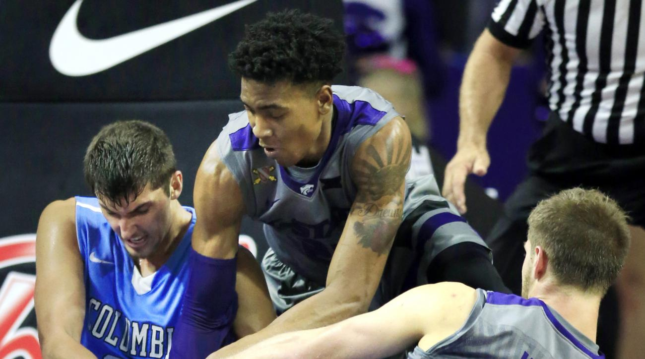 Columbia forward Luke Petrasek, left, Kansas State forwards Wesley Iwundu, Center, and Dean Wade (32) go to the floor after a loose ball during the second half of an NCAA college basketball game in Manhattan, Kan., Monday, Nov. 16, 2015. Kansas State defe