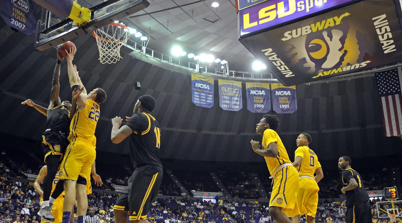 LSU center Darcy Malone (22) blocks the shot of  Kennesaw State guard Kendrick Ray, left, in the first half of an NCAA college basketball game in Baton Rouge, La., Monday, Nov. 16, 2015. LSU won 91-69. (AP Photo/Bill Feig)