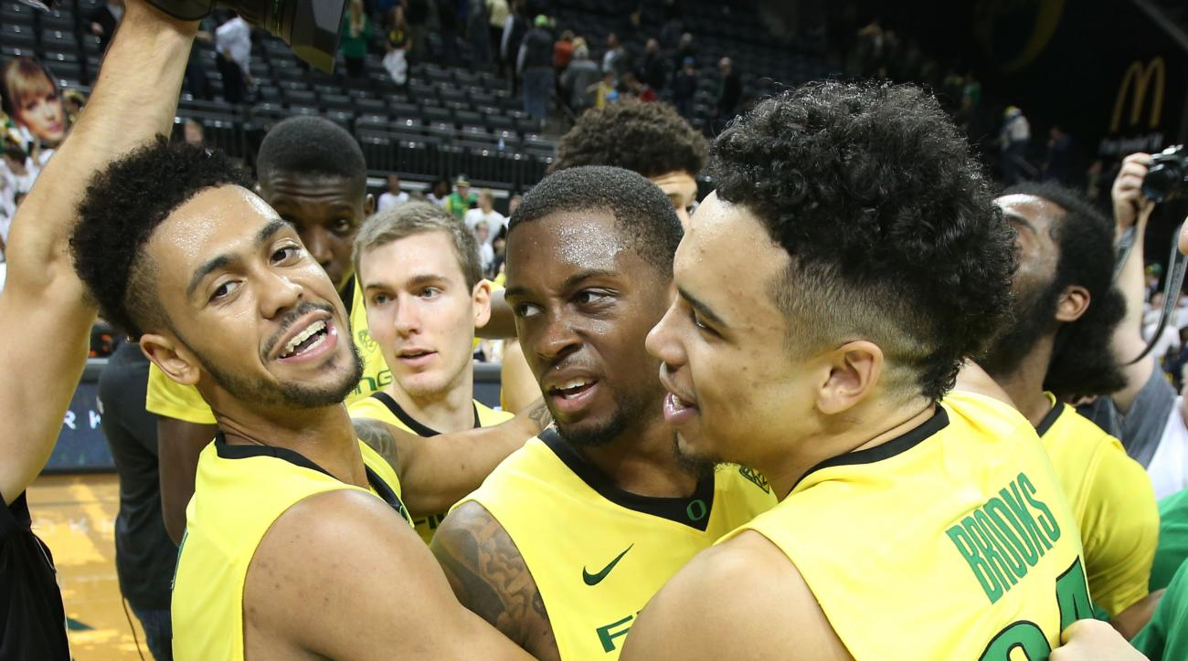 Oregon's Tyler Dorsey, left, Elgin Cook and Dillon Brooks celebrate their 74-67 victory over Baylor in an NCAA college basketball game Monday Nov. 16, 2015 in Eugene, Ore. (AP Photo/Chris Pietsch)