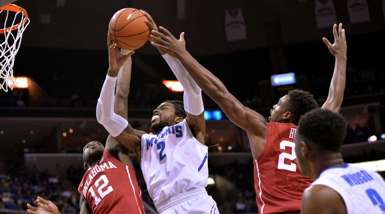 Memphis forward Shaq Goodwin (2) shoots between Oklahoma forward Khadeem Lattin (12) and guard Buddy Hield, right, in the first half of an NCAA college basketball game, Tuesday, Nov. 17, 2015, in Memphis, Tenn. (AP Photo/Brandon Dill)