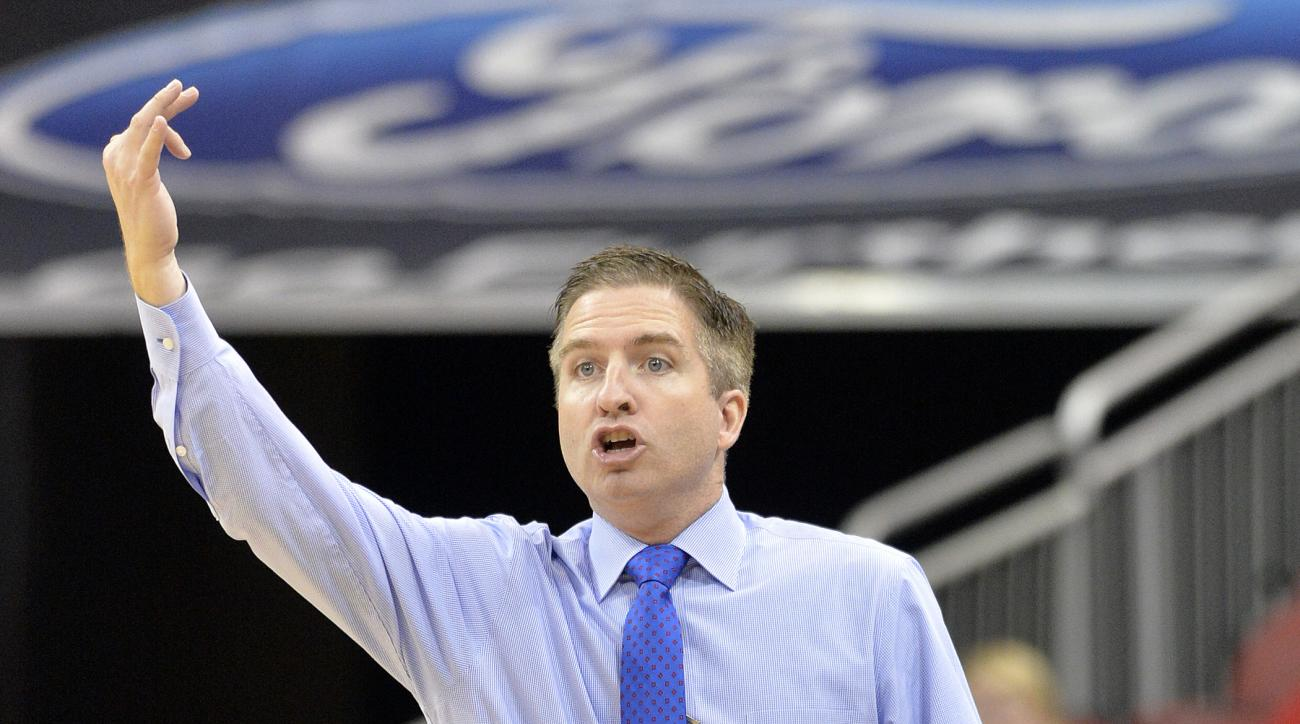 Hartford head coach John Gallagher sends a play in to his team during the first half of an NCAA college basketball game against Louisville, Tuesday, Nov. 17, 2015, in Louisville, Ky.  (AP Photo/Timothy D. Easley)