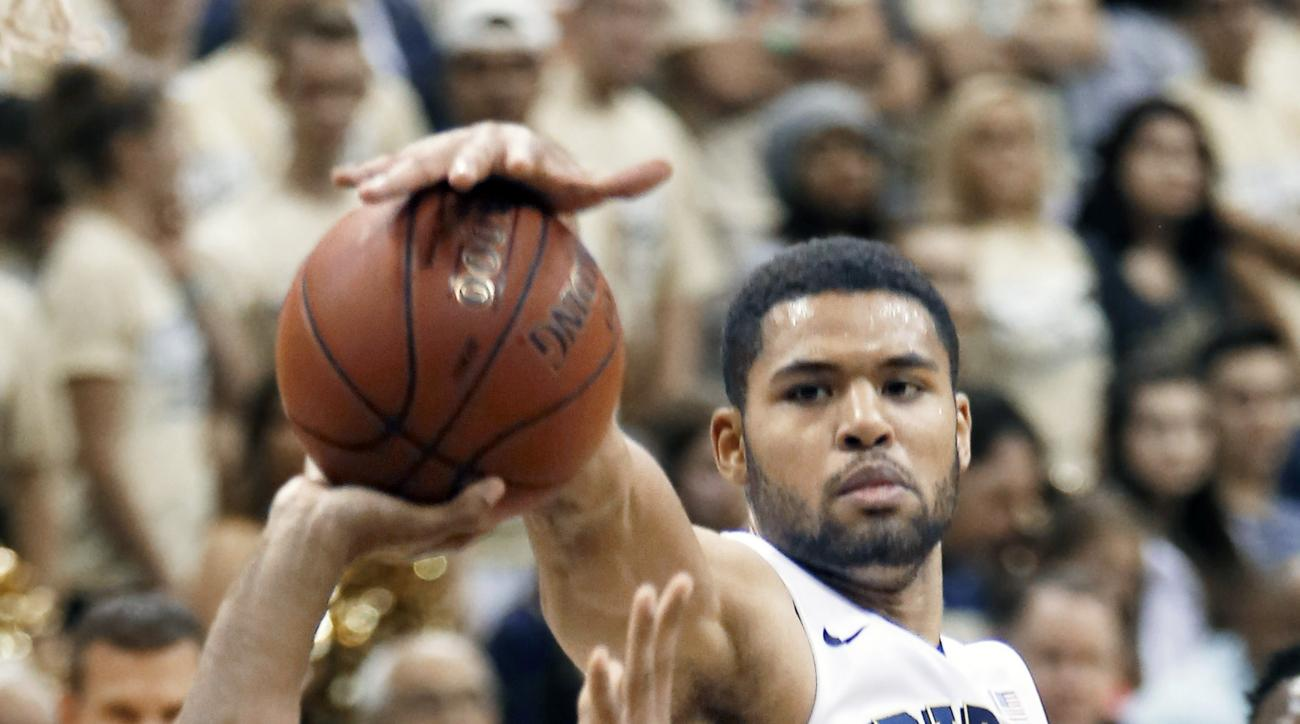 Pittsburgh's Alonzo Nelson-Ododa (33) blocks a shot by Saint Joseph's (Ind.) Chris Nunn (10) in the second half of an NCAA college basketball game, Tuesday, Nov. 17, 2015, in Pittsburgh. Pittsburgh won 84-43. (AP Photo/Keith Srakocic)