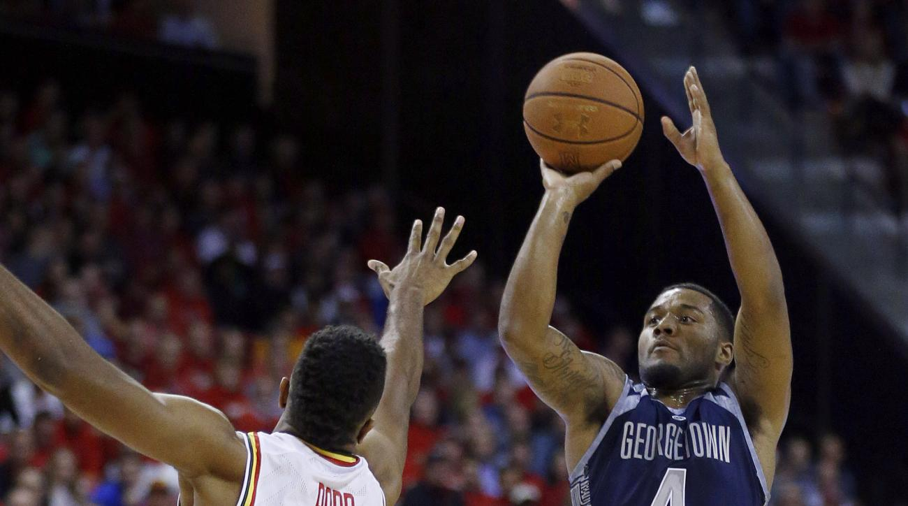 Georgetown guard D'Vauntes Smith-Rivera, right, shoots over Maryland forward Damonte Dodd in the first half of an NCAA college basketball game, Tuesday, Nov. 17, 2015, in College Park, Md. (AP Photo/Patrick Semansky)