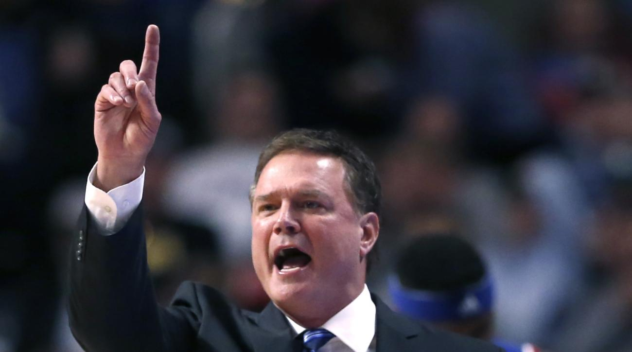 Kansas head coach Bill Self directs his players from the bench  during the first half of an NCAA college basketball game against Michigan State on Tuesday, Nov. 17, 2015. (AP Photo/Charles Rex Arbogast)