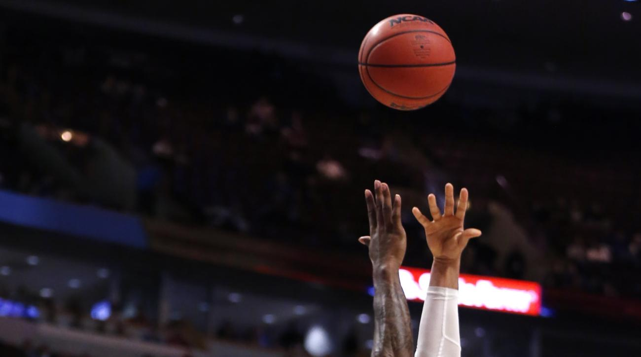 Michigan State guard Denzel Valentine, right, shoots over Kansas forward Jamari Traylor during the second half of an NCAA college basketball game on Tuesday, Nov. 17, 2015. Michigan State won 79-73. (AP Photo/Charles Rex Arbogast)
