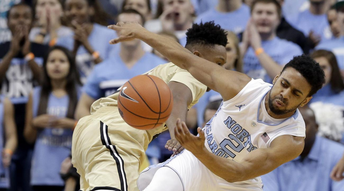 North Carolina's Joel Berry II (2) and Wofford's Justin Gordon struggle for possession of the ball during the first half of an NCAA college basketball game in Chapel Hill, N.C., Wednesday, Nov. 18, 2015. (AP Photo/Gerry Broome)