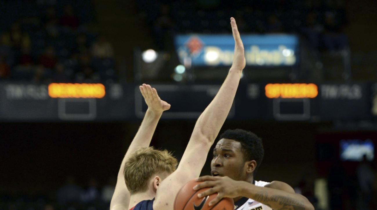 Wake Forest's Bryant Crawford  (13) leans into Richmond's Paul Friendshuh as he shoots during the first half of an NCAA college basketball game at Joel Coliseum in Winston-Salem, N.C., Wednesday, Nov. 18, 2015. (Walt Unks/The Winston-Salem Journal via AP)