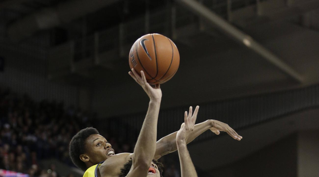 Gonzaga's Josh Perkins (13) takes a shot while defended by during Northern Arizona's Marcus DeBerry during the first half of an NCAA college basketball game, Wednesday, Nov. 18, 2015, in Spokane, Wash. (AP Photo/Young Kwak)