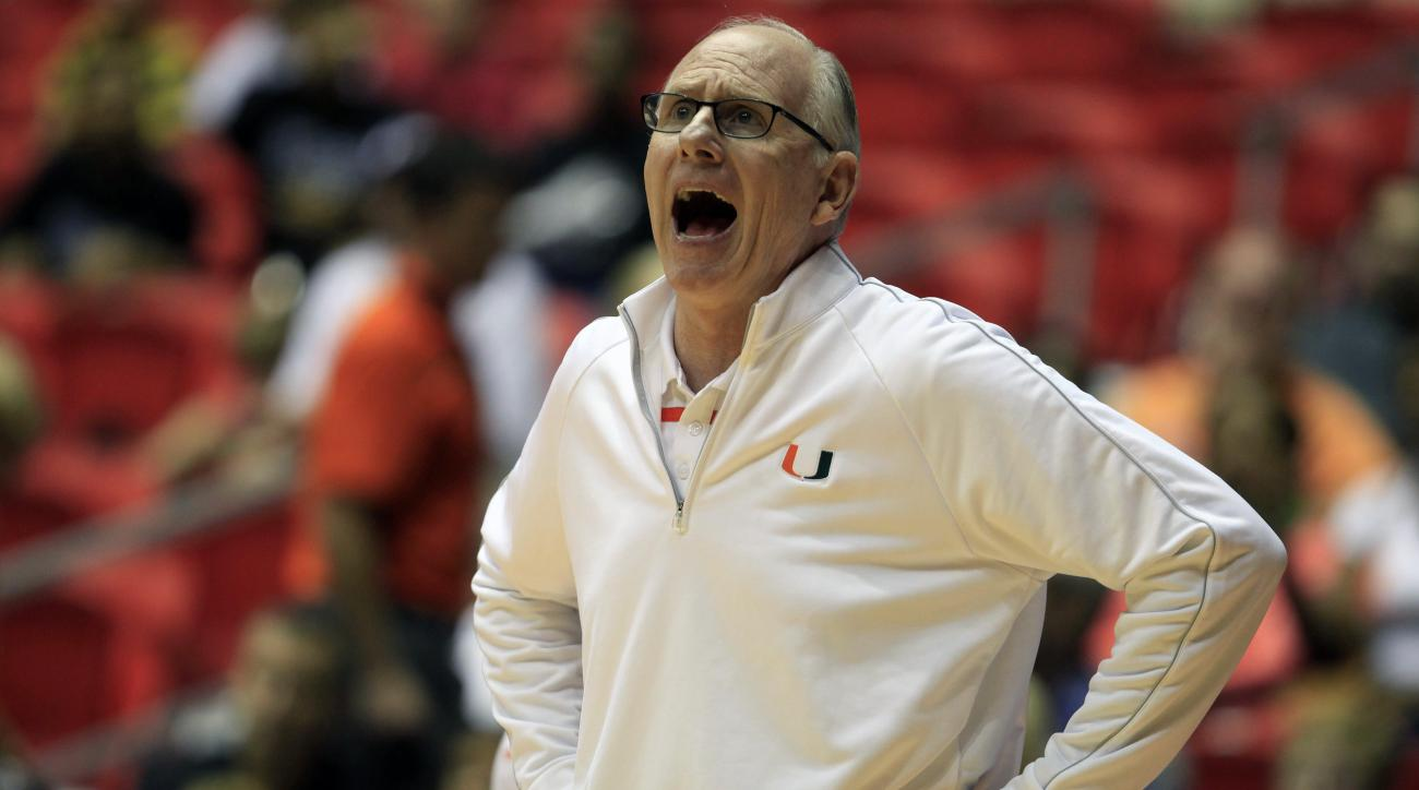 University of Miami basketball coach Jim Larranaga yells out instructions to his players during the first half of the Puerto Rico Tip-Off college basketball tournament against Mississippi St. in San Juan, Thursday, Nov. 19, 2015. (AP Photo/Ricardo Ardueng