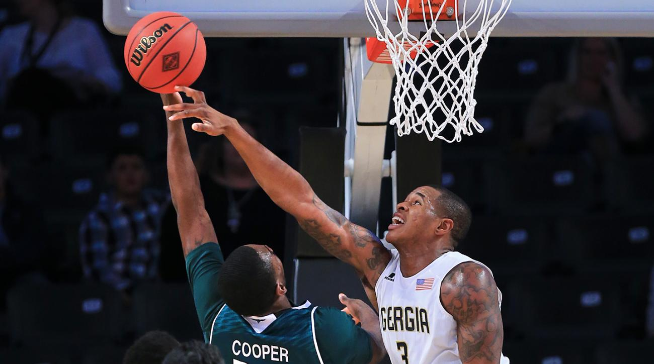 Georgia Tech guard Marcus Georges-Hunt blocks a shot by Green Bay guard Charles Cooper during an NIT Season Tip-Off NCAA college basketball game Thursday, Nov. 19, 2015, in Atlanta. (Curtis Compton/Atlanta Journal Constitution via AP)