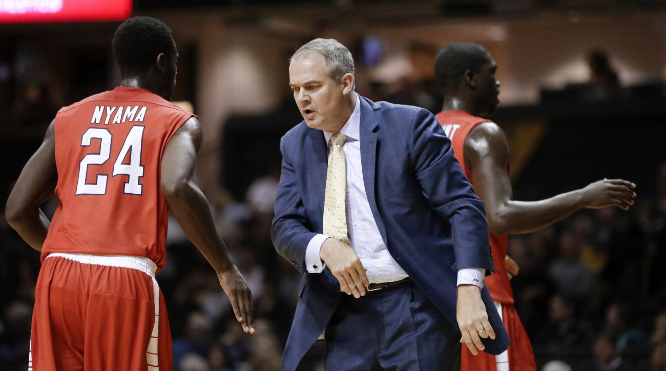 Stony Brook coach Steve Pikiell  congratulates guard Roland Nyama (24) after a play during the first half of an NCAA college basketball game against Vanderbilt on Thursday, Nov. 19, 2015, in Nashville, Tenn. (AP Photo/Mark Humphrey)