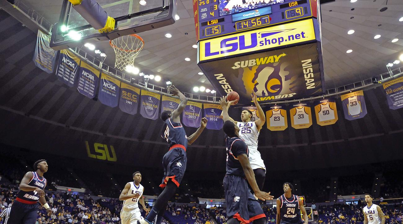 LSU forward Ben Simmons (25) puts the ball up for two points as South Alabama forwards Tafari Whittingham (20) and Don MuepoKelly (5) defend during the first half of an NCAA college basketball game in Baton Rouge, La., Thursday, Nov. 19, 2015. (AP Photo/B