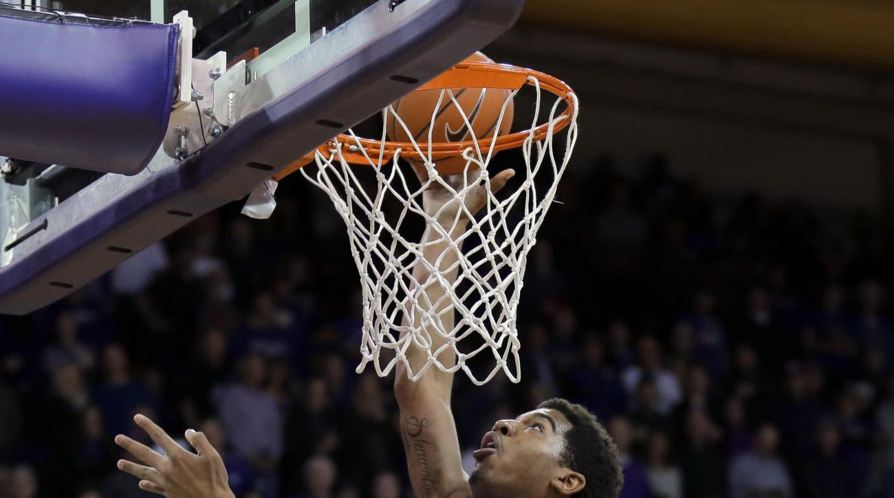 Washington forward Marquese Chriss shoots bove Mount St. Mary's guard Charles Glover (12) during the first half of an NCAA college basketball game, Thursday, Nov. 19, 2015, in Seattle. (AP Photo/Ted S. Warren)