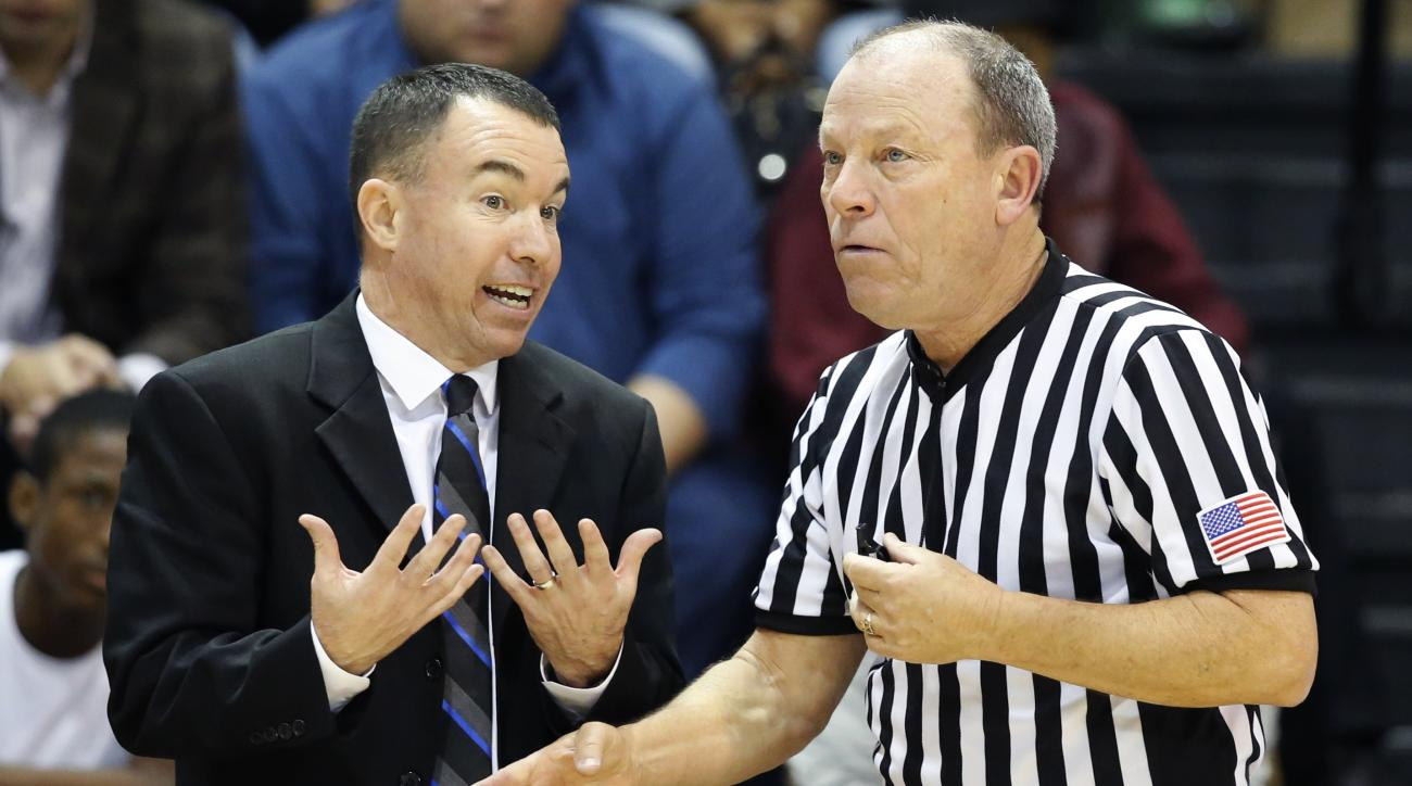 Maine coach Bob Walsh, left, reacts as NCAA official Ed Corbett explains a penalty for unofficial substitutions in the final minute of an NCAA college basketball game between LIU Brooklyn and Maine in New York, Thursday, Nov. 19, 2015. LIU Brooklyn defeat