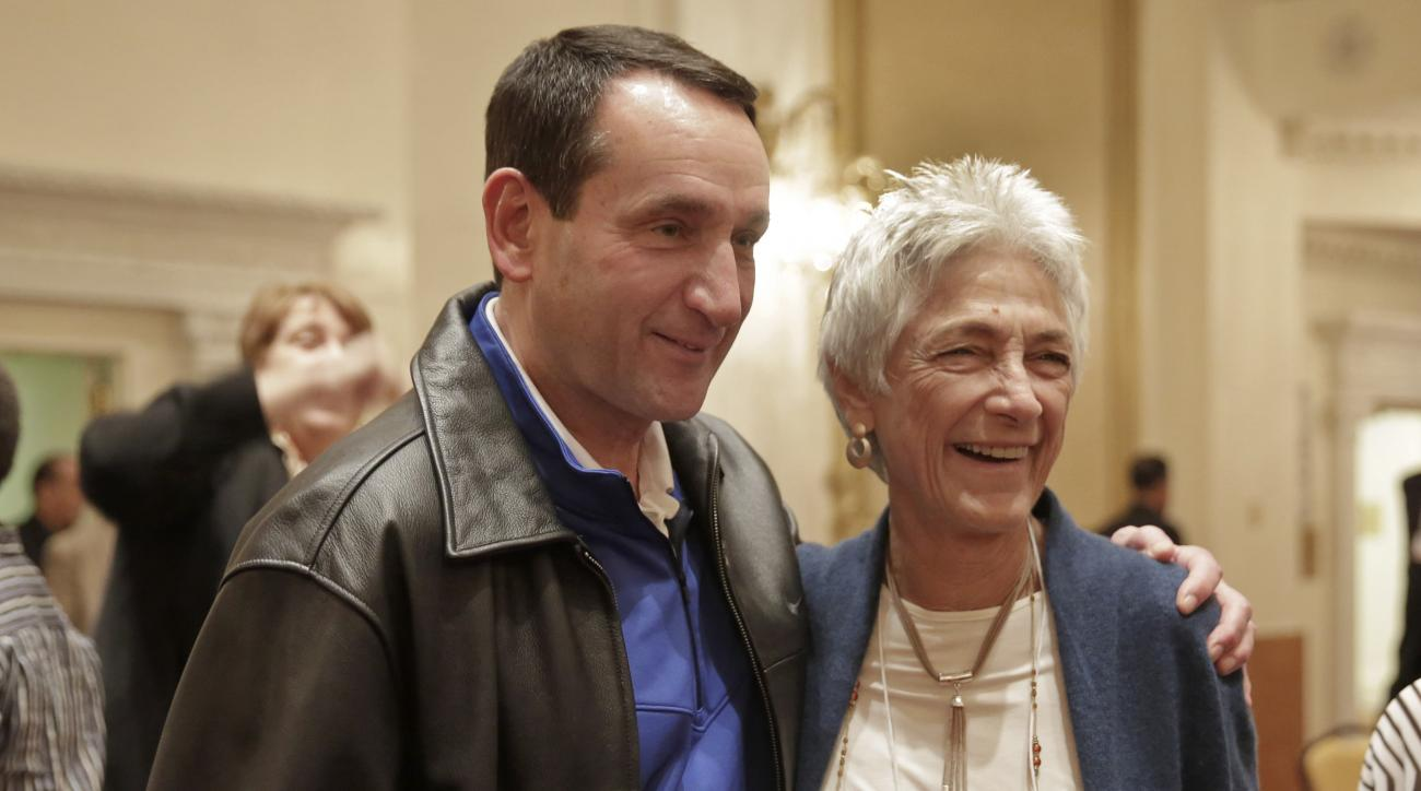 Duke University basketball coach Mike Krzyzewski and former Queens College women's basketball coach Lucille Kyvallos, winners of the Lapchick Character Award, pose for photos at the organization's annual luncheon, in New York, Friday, Nov. 20, 2015. (AP P