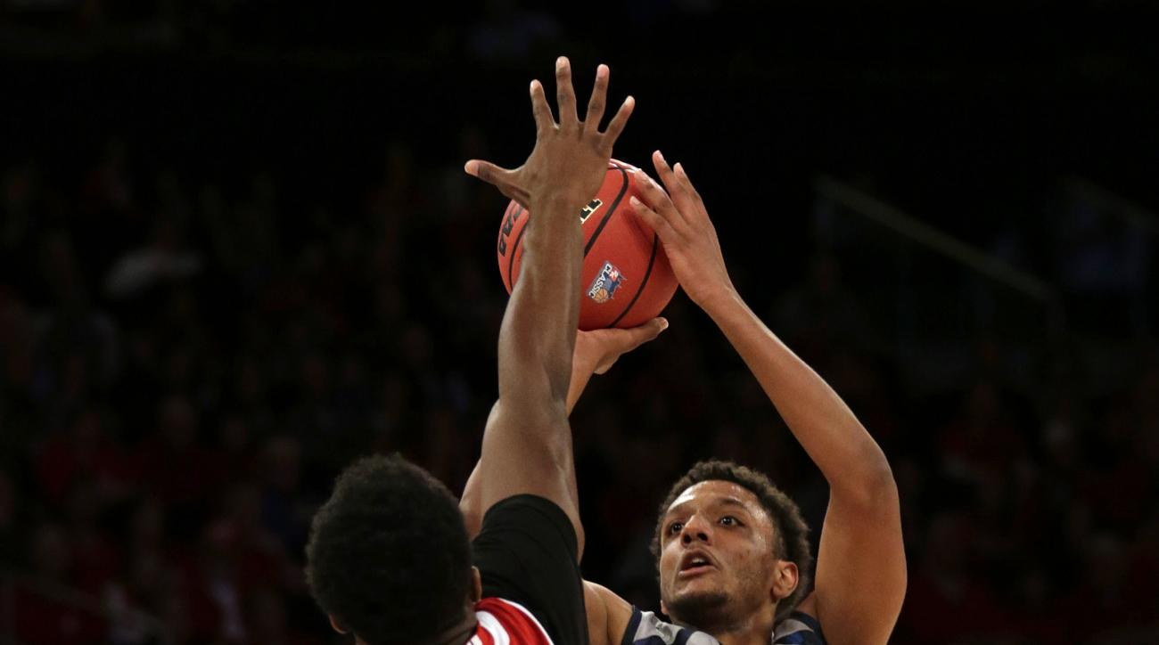Georgetown forward Reggie Cameron (5) shoots over Wisconsin forward Khalil Iverson (21) during the first half of an NCAA college basketball game at Madison Square Garden on Friday, Nov. 20, 2015, in New York. (AP Photo/Adam Hunger)