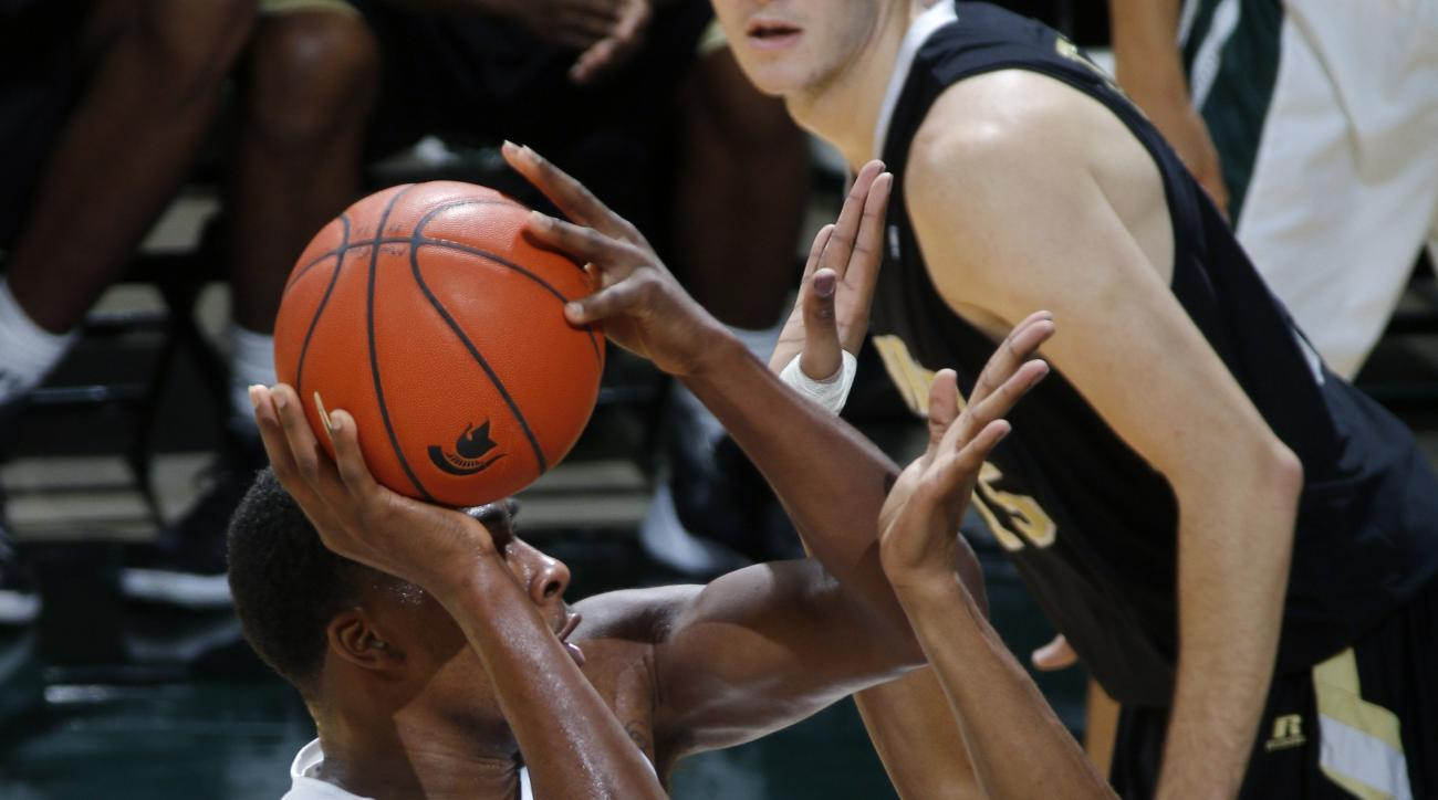 Michigan State's Javon Bess, left, shoots against Arkansas-Pine Bluff's JoVaughn Love, right, during the first half of an NCAA college basketball game, Friday, Nov. 20, 2015, in East Lansing, Mich. (AP Photo/Al Goldis)