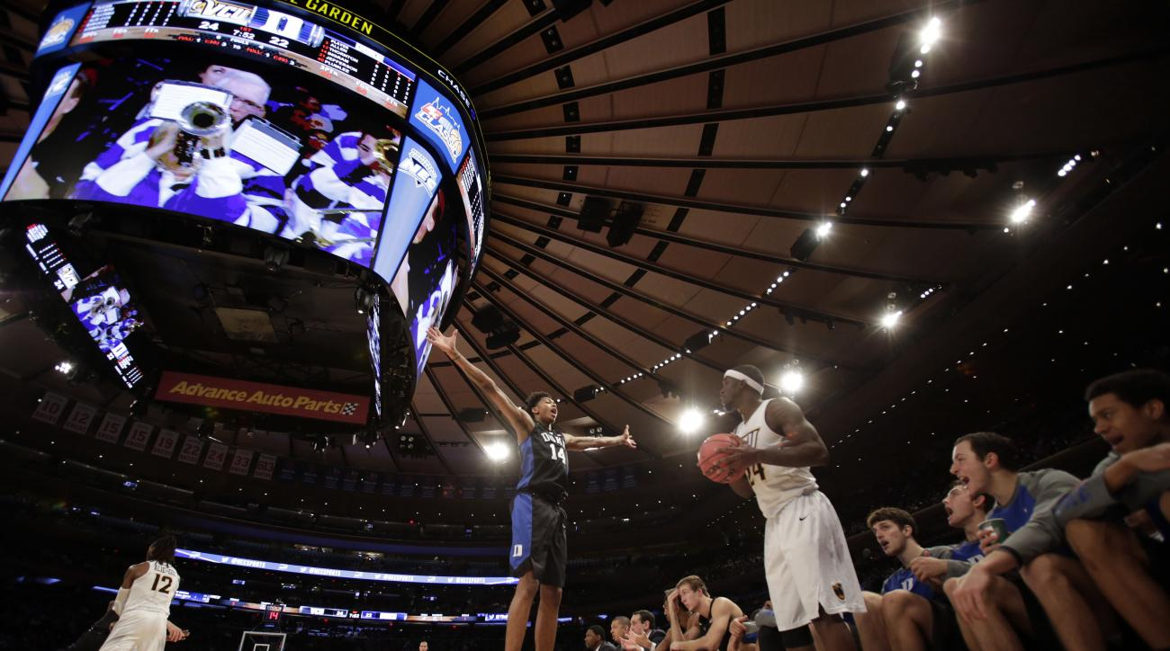 Virginia Commonwealth guard Korey Billbury (24) looks to inbound the ball being defended by Duke guard Brandon Ingram (14) during the first half of an NCAA college basketball game at Madison Square Garden on Friday, Nov. 20, 2015, in New York. (AP Photo/A