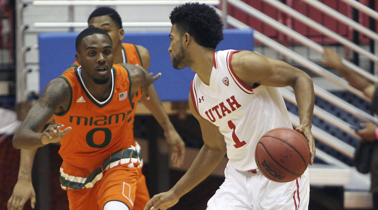 Miami guard Ja'Quan Newton (0) pressures Utah guard Isaiah (1) Wright during the Puerto Rico Tip-Off college basketball tournament in San Juan, Puerto Rico, Friday, Nov. 20, 2015. (AP Photo/Ricardo Arduengo)