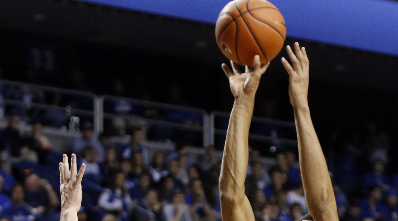 Kentucky's Skal Labissiere (1) shoots over Wright State's JT Yoho during the first half of an NCAA college basketball game Friday, Nov. 20, 2015, in Lexington, Ky. (AP Photo/James Crisp)