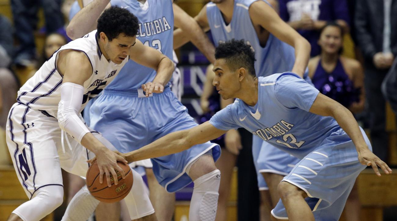Columbia guard Maodo Lo, right, steals the ball from Northwestern forward Aaron Falzon, left, during the first half of an NCAA college basketball game on Friday, Nov. 20, 2015, in Evanston, Ill.  (AP Photo/Nam Y. Huh)