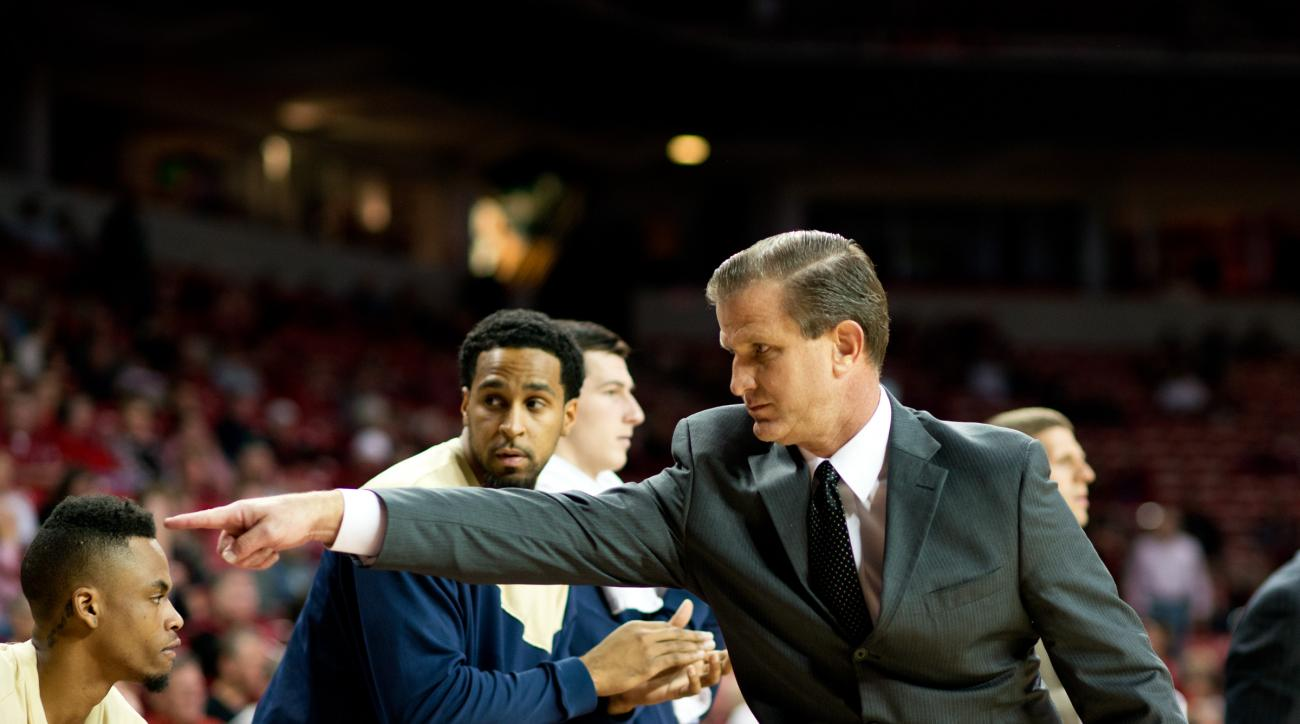 Charleston Southern head coach Barclay Radebaugh points to a player during the first half of an NCAA college basketball game against Arkansas in Fayetteville, Ark., Friday, Nov. 20, 2015. (AP Photo/Sarah Bentham)