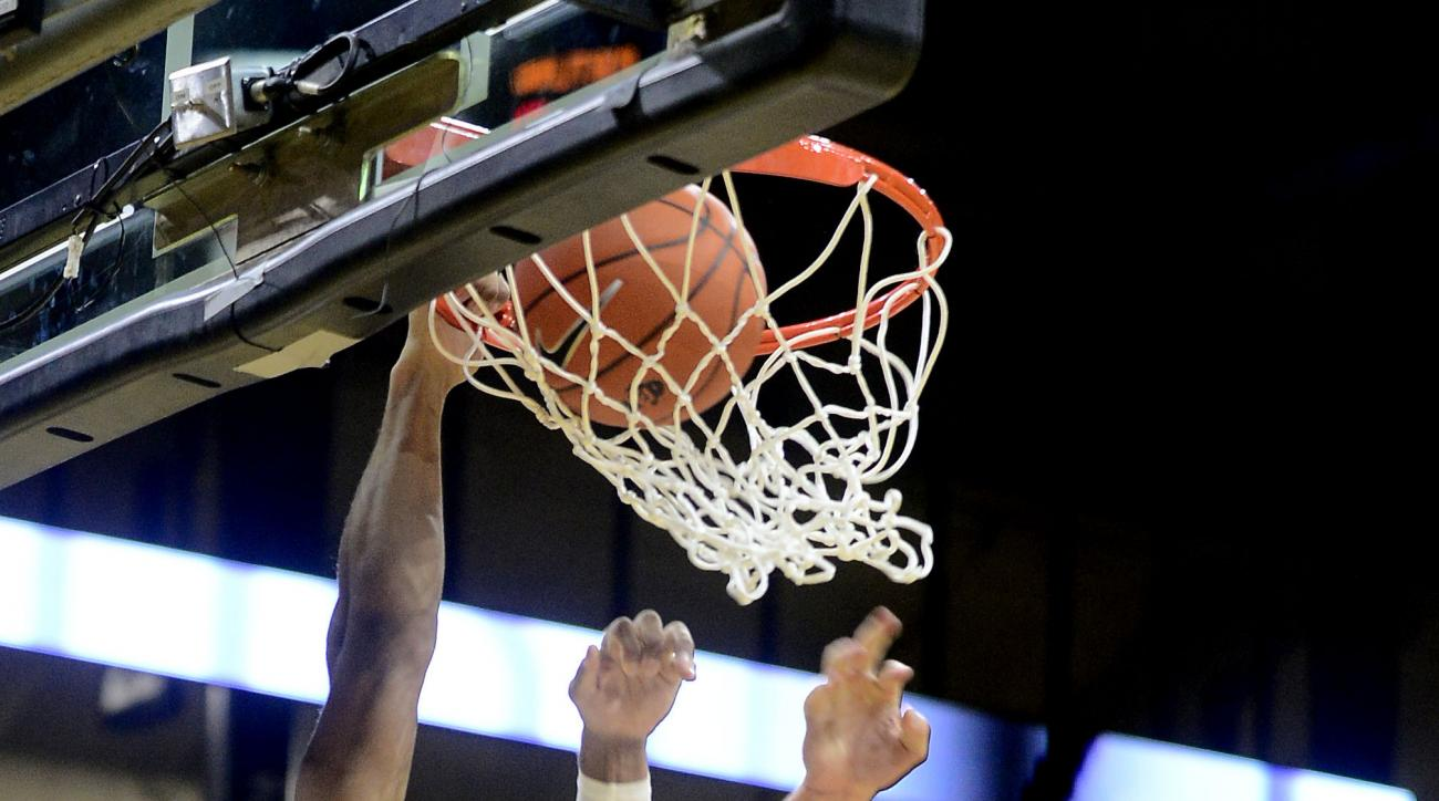 Colorado's Josh Fortune, left, dunks over Portland's Gabe Taylor, right, during the first half of an NCAA college basketball game Friday, Nov. 20, 2015, in Boulder, Colo. (Cliff Grassmick/Daily Camera via AP)