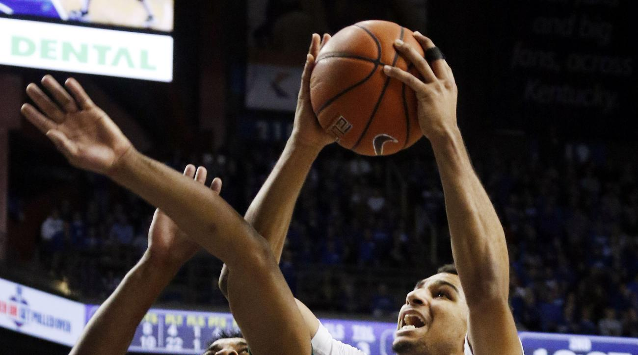 Kentucky's Jamal Murray, right, shoots next to Wright State's Mark Alstork during the second half of an NCAA college basketball game Friday, Nov. 20, 2015, in Lexington, Ky. Kentucky won 78-63. (AP Photo/James Crisp)