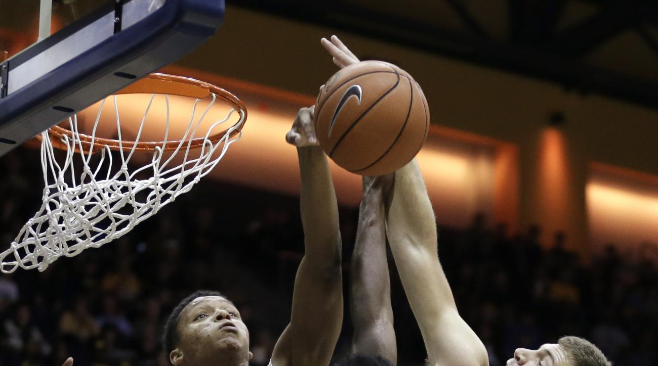 East Carolina's Michael Zangari, right, shoots against California's Ivan Rabb, left, during the first half of an NCAA college basketball game Friday, Nov. 20, 2015, in Berkeley, Calif. (AP Photo/Ben Margot)