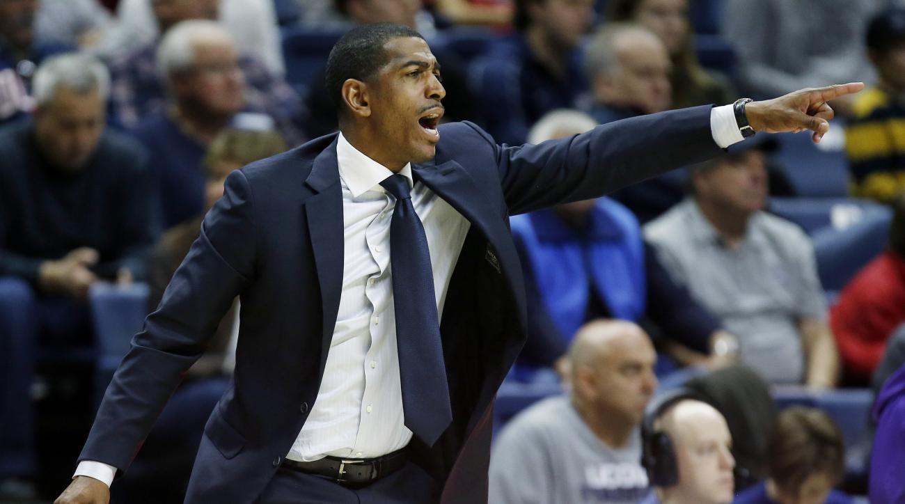 Connecticut head coach Kevin Ollie yells to his team during the first half of an NCAA college basketball game against Furman in Storrs, Conn., Saturday, Nov. 21, 2015. (AP Photo/Michael Dwyer)