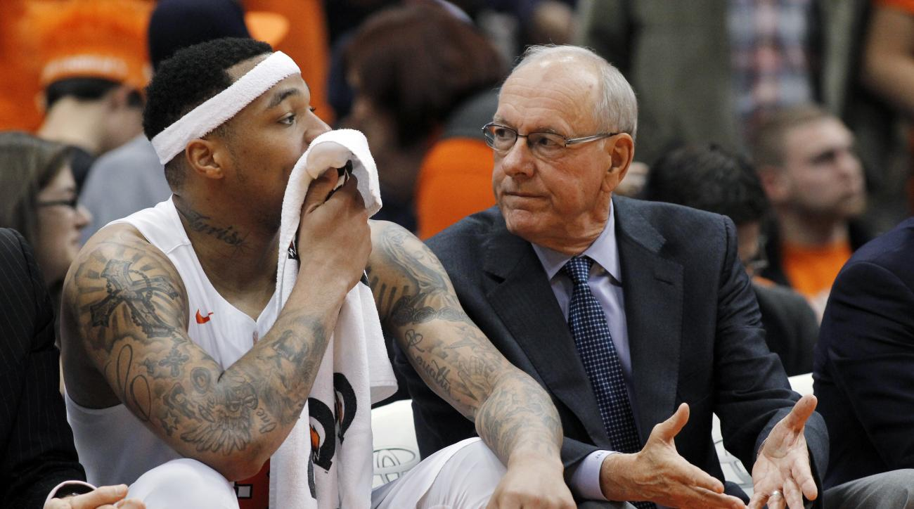 Syracuse coach Jim Boeheim, right, talks with Dajuan Coleman on the bench during the second half of an NCAA college basketball game against Elon in Syracuse, N.Y., Saturday, Nov. 21, 2015. Syracuse won 66-55. (AP Photo/Nick Lisi)