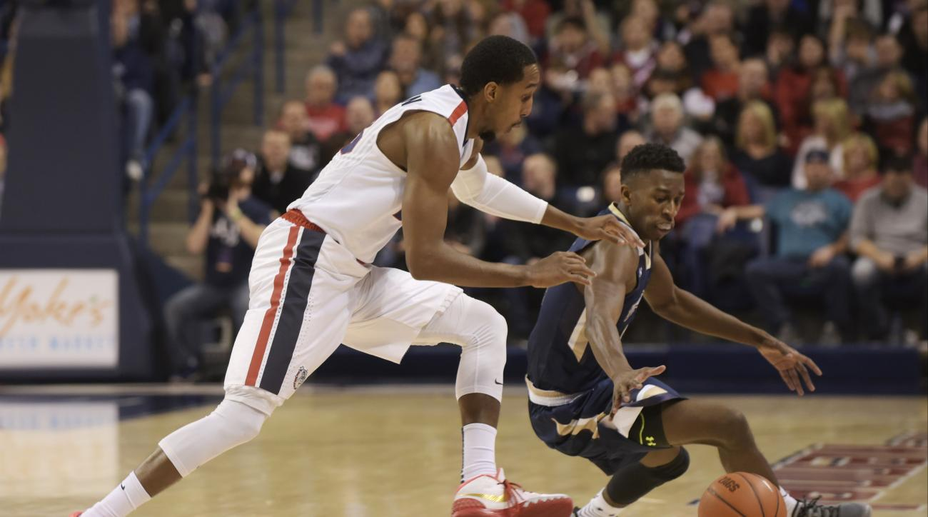 Gonzaga's Eric McClellan, left, and against Mount St. Mary's Khalid Nwandu (4) chase a loose ball during the first half of an NCAA college basketball game, Saturday, Nov. 21, 2015, in Spokane, Wash. (AP Photo/Rajah Bose)