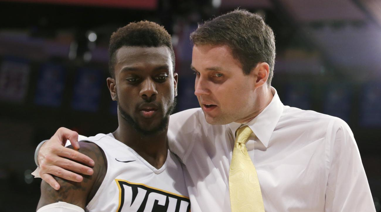 Virginia Commonwealth coach Will Wade walks off the court with guard JeQuan Lewis after the first half of an NCAA college basketball game against Wisconsin in the third-place game of the 2K Classic at Madison Square Garden in New York, Sunday, Nov. 22, 20