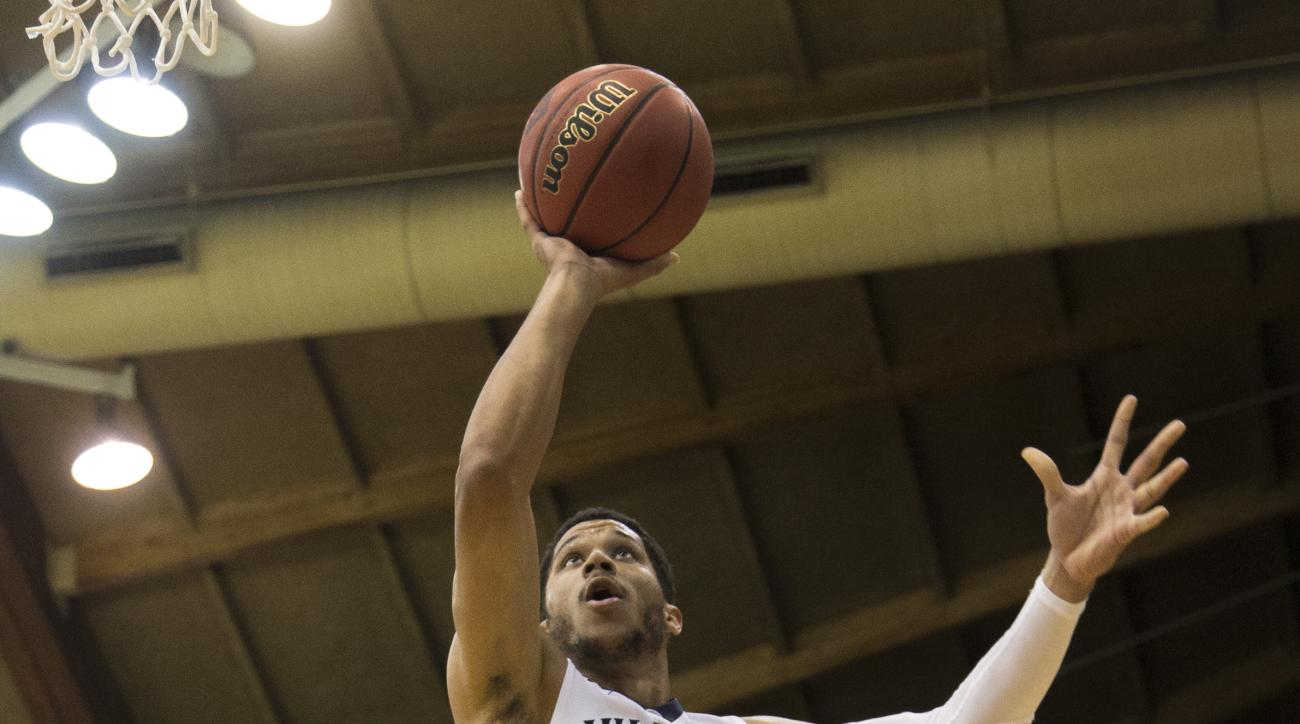 Villanova guard Josh Hart (3) goes to the basket past Akron guard Antino Jackson (55) in the first half of an NCAA college basketball game, Sunday, Nov. 22, 2015, in Villanova, Pa. (AP Photo/Laurence Kesterson)