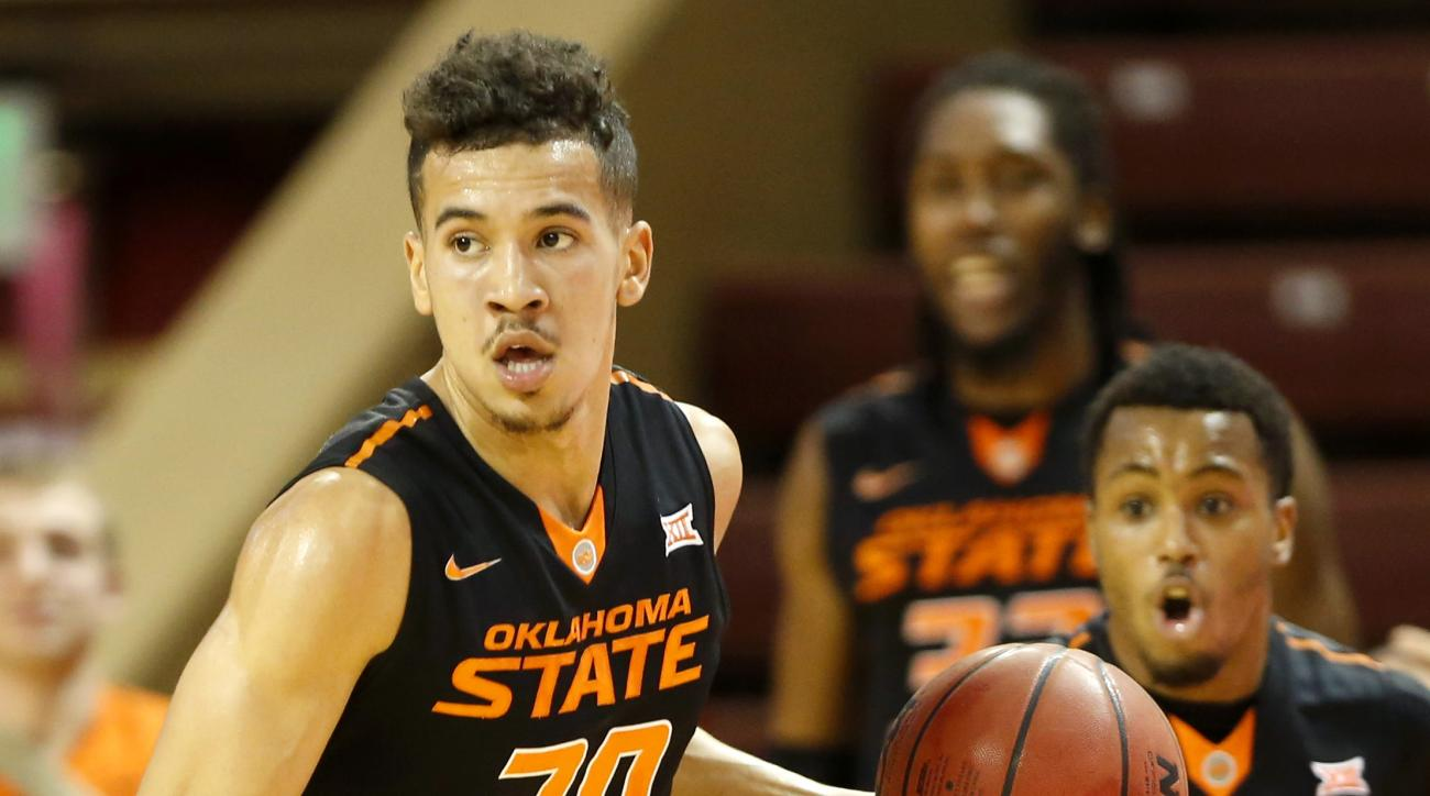Oklahoma State's Jeffrey Carroll (30) dribbles up court against Long Beach State's defense during first half action of an NCAA college basketball game at the Charleston Classic, Sunday Nov. 22, 2015, in Charleston, S.C.  (AP Photo/Mic Smith)