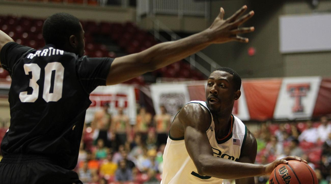Butler forward Kelan Martin, left, pressures Miami guard Davon Reed during the Puerto Rico Tip-Off college basketball tournament in San Juan, Sunday, Nov. 22, 2015. (AP Photo/Ricardo Arduengo