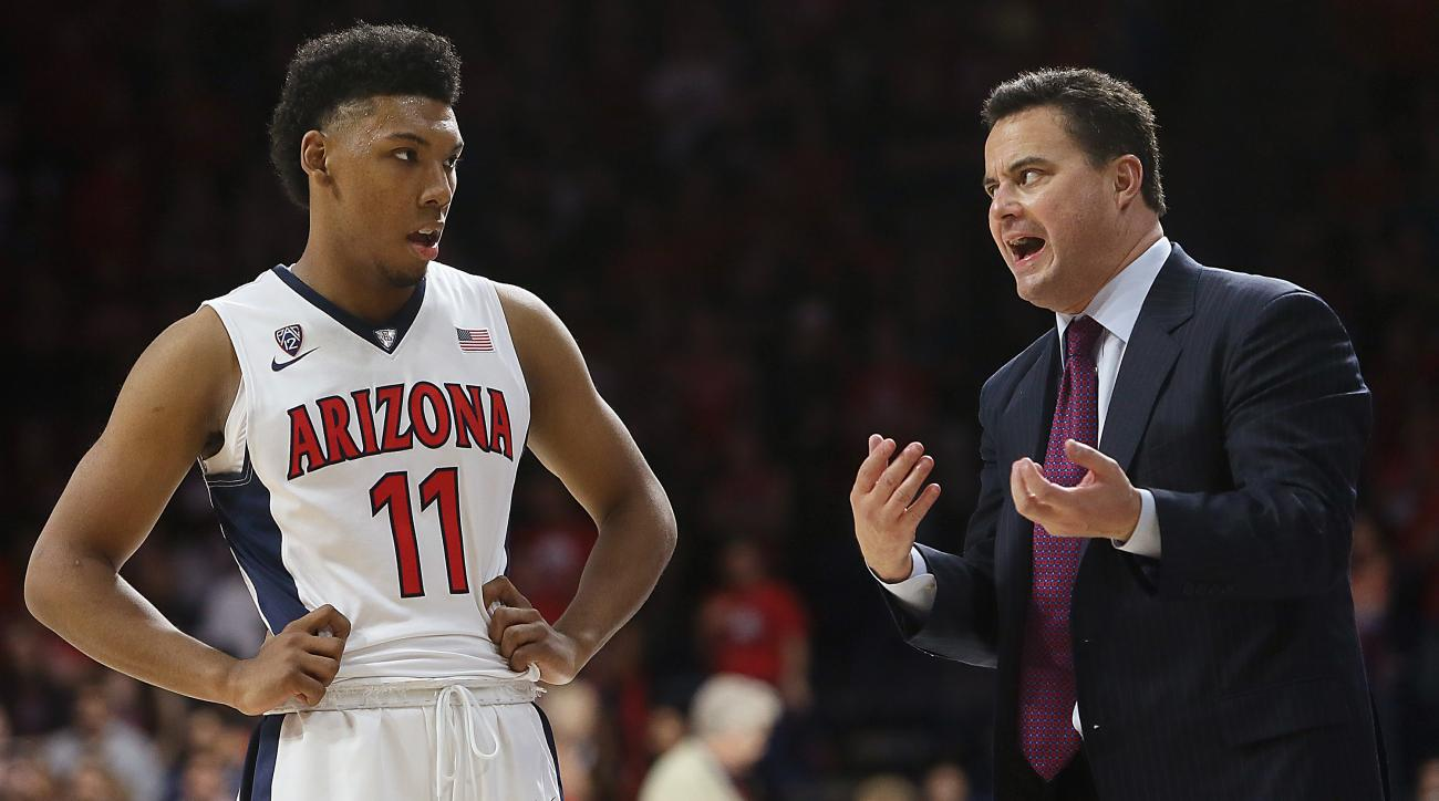 Arizona head coach Sean Miller talks with guard Allonzo Trier (11) during the second half of an NCAA college basketball game against Northwestern State in Tucson, Ariz., Sunday, Nov. 22, 2015. (Mamta Popat/Arizona Daily Star via AP)  ALL LOCAL TELEVISION