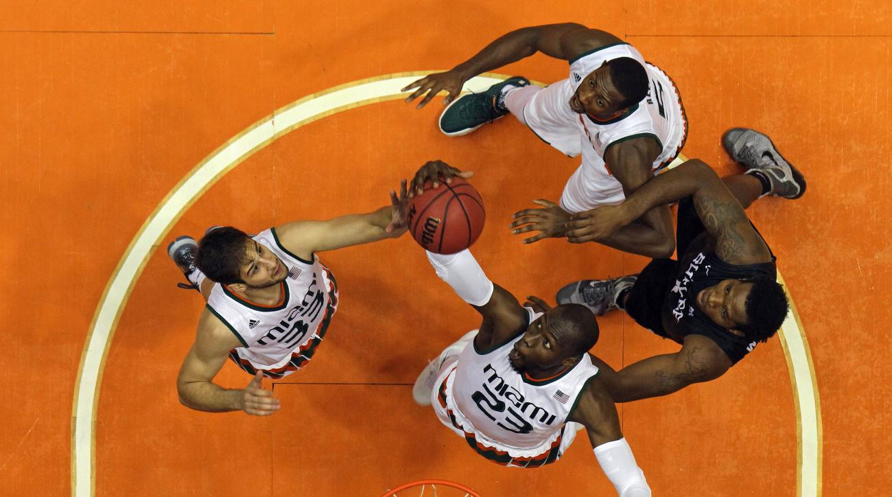 Miami's Tonye Jekiri (23), Ivan Cruz (33) and Davon Reed (5) battle for a rebound against Butler forward Tyler Wideman during the Puerto Rico Tip-Off college basketball tournament in San Juan, Sunday, Nov. 22, 2015. (AP Photo/Ricardo Arduengo)